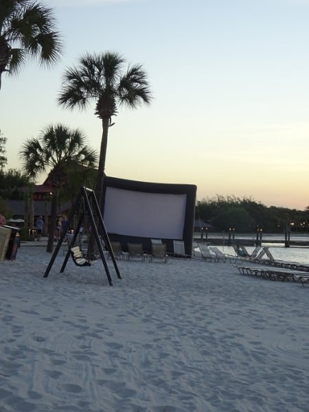 setting up the screen for movies under the stars