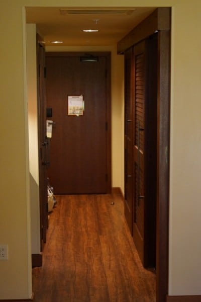hallway that leads to closet and the split bathrooms